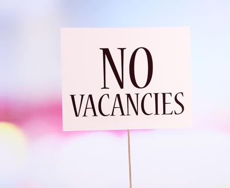 vacancies: Nameplate with inscription No vacancies on bright background Stock Photo