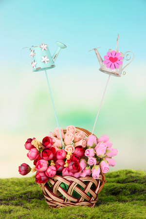 Metal decoration for flowers and bouquet in basket on natural background photo