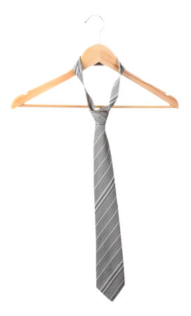 ironed: Elegant grey  tie on wooden hanger isolated on white Stock Photo
