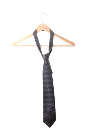 Elegant grey tie on wooden hanger isolated on white photo