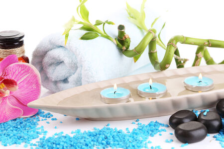 Beautiful spa setting with flower isolated on white photo