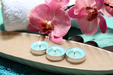 Beautiful spa setting with flower on bright background Stock Photo