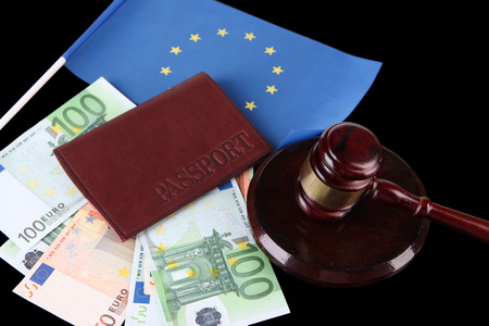 Gavel, money, passport and flag of Europe, on wooden background photo