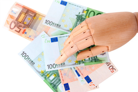 economise: Money in wooden hand, isolated on white