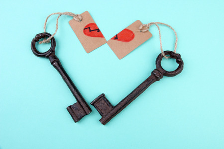 Keys to heart, Conceptual photo. On color background photo