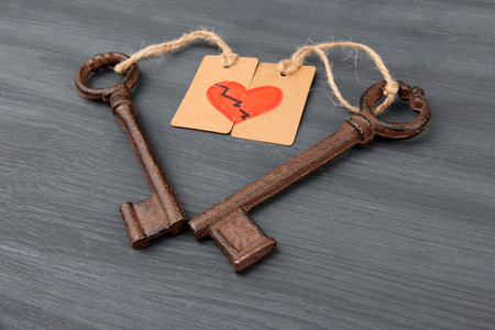 Keys to heart, Conceptual photo. On color wooden background photo