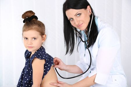 Little girl at doctor Stock Photo
