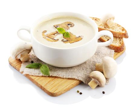Mushroom soup in white bowl, on napkin, isolated on white photo