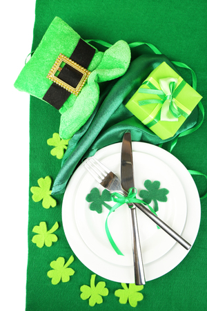 Table setting for St Patricks Day with white background photo