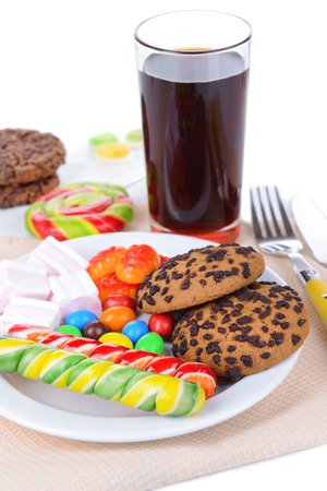 Different sweets on plate on table close-up photo