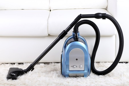 keeping room: Vacuum cleaner to tidy up the living room Stock Photo
