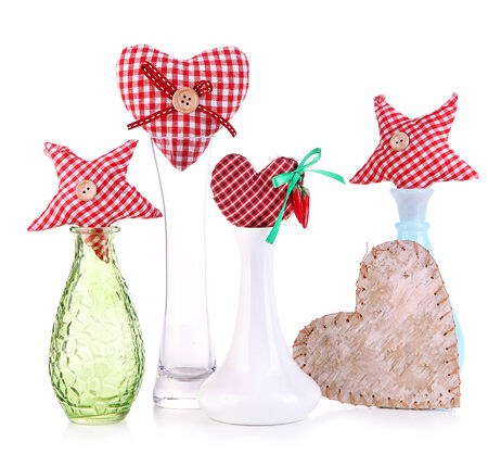 Hand-made textile hearts in different vases, isolated on white photo