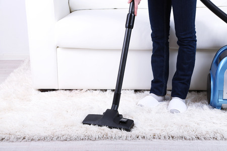 Cleaning home with vacuum cleaner photo