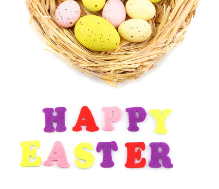 Easter eggs in nest and Happy Easter sign, isolated on white photo