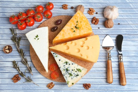 chees: Different Italian cheese on wooden table