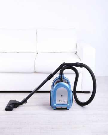 Vacuum cleaner to tidy up the living room photo