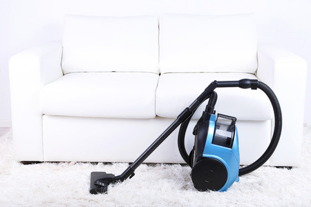 Vacuum cleaner to tidy up the living room Stock Photo - 26981652
