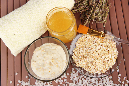 sea oats: Homemade facial mask with oats and honey,on color wooden  Stock Photo