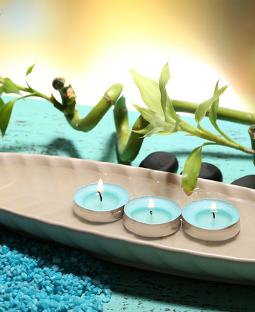 Beautiful spa setting with bamboo on wooden table, on bright  photo