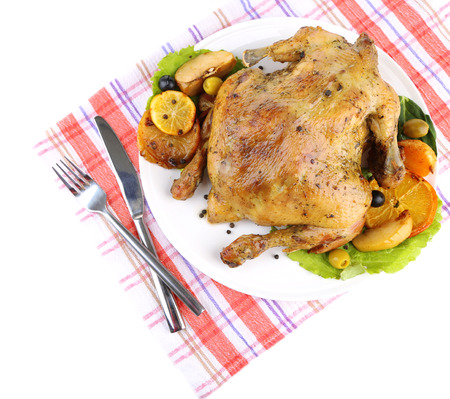 Composition with Whole roasted chicken with vegetables, color napkin, on plate, isolated on white photo