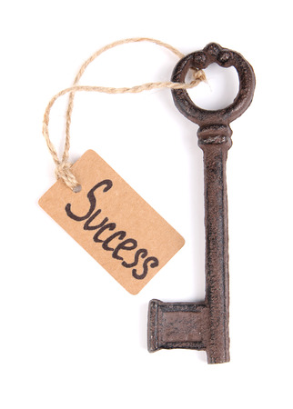 Key to success, Conceptual photo. Isolated on white photo
