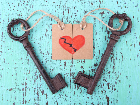 Keys to love, Conceptual photo. On color wooden background photo