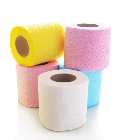 Colorful toilet paper rolls isolated on white photo