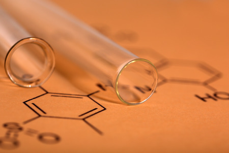 Test tubes and reaction formula, close-up photo