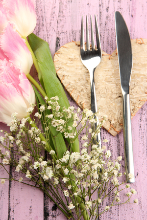 Table place setting with decorations on color wooden background photo