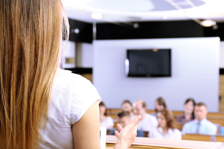 Businesswoman is making speech at conference room photo
