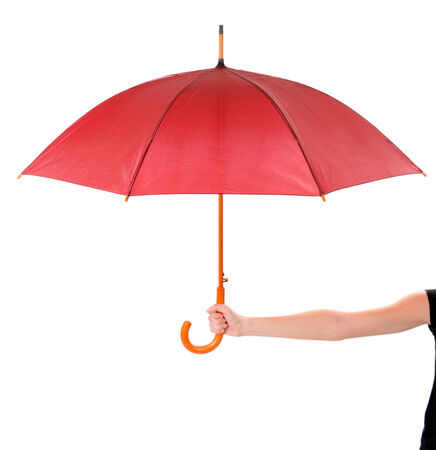 Red Umbrella in hand isolated on white photo