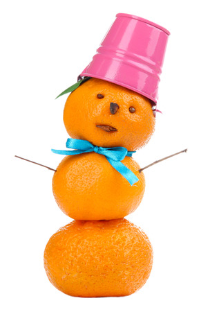 Snowman, prepared with tangerines, isolated on white photo