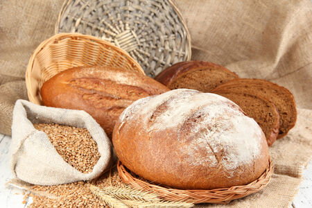 Rye bread with grains on table on sackcloth background photo
