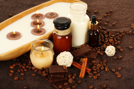 Beautiful chocolate spa setting on wooden table close-up photo
