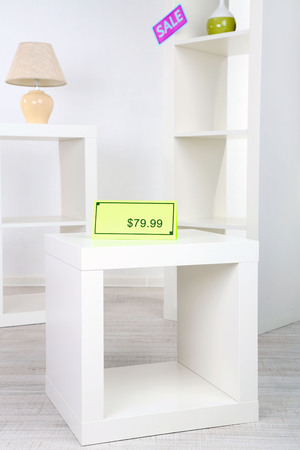 New white shelves with prices on light background photo
