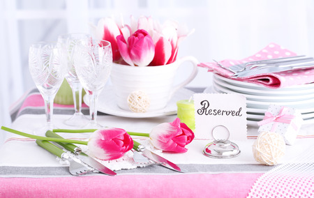 Beautiful spring table setting on light background photo