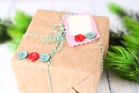 Paper gift box on wooden background photo