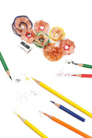 Colorful pencils and pencil shavings, isolated on white photo