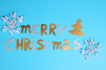 Merry Christmas lettering on grey background photo