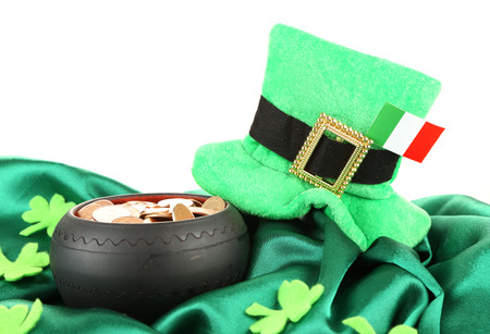 Saint Patrick day hat, pot of gold coins and Irish flag, isolated on white photo