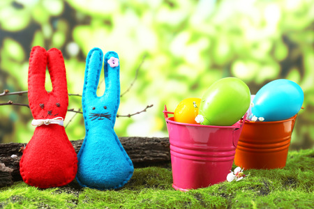 Funny handmade Easter rabbits on green grass photo