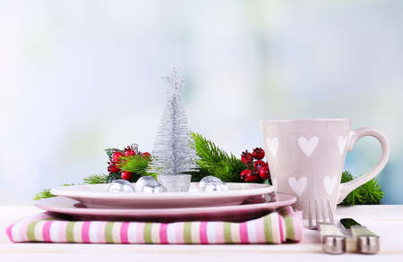 Set of utensil for Christmas dinner, on table, on light background photo