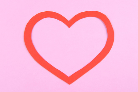 Paper heart on pink background photo