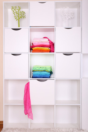 White shelves with colored clothing close up Stock Photo