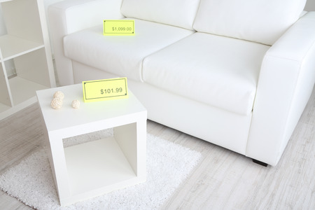 New white furniture with prices on light background photo