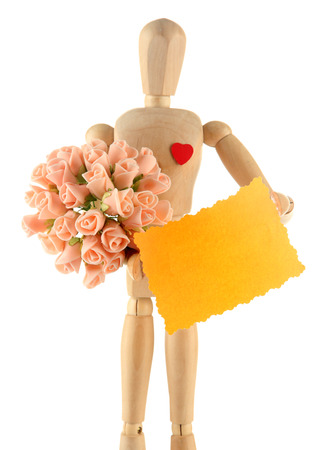 Wooden mannequin holding blank label and bouquet isolated on white photo