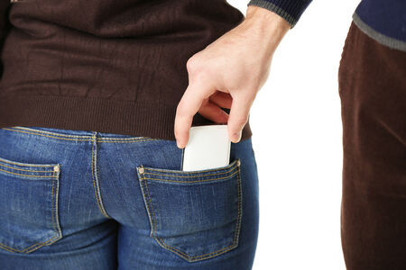 inattention: Pickpocket are stealing mobile phone from back pocket, close up, isolated on white