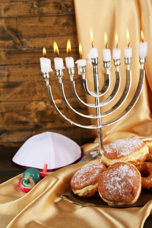 Festive composition for Hanukkah on cloth close-up photo