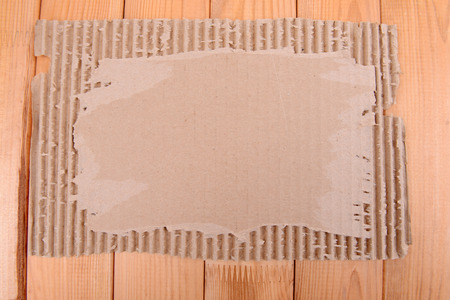 Cardboard on wooden background photo
