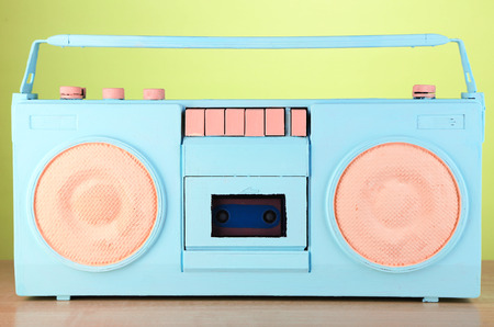 Colorful retro radio, on green background photo